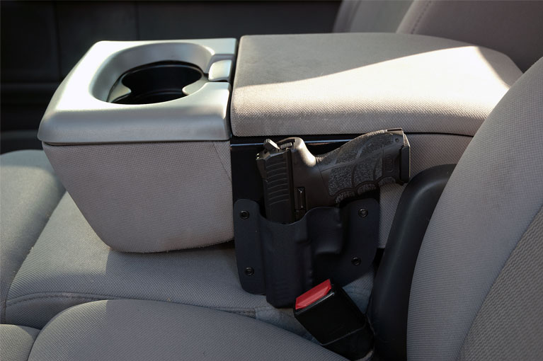 Vehicle console holster discrete defense solutions